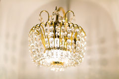 Golden  crystal chandelier Stock Images