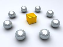 Golden cube and steel spheres Stock Image