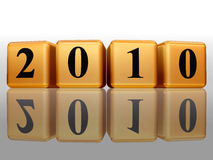 Golden cubes with 2010, reflection. 3d golden cubes with black figures with text 2010 with reflection Royalty Free Stock Images