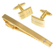 Golden cuff link and tie pin Stock Photos