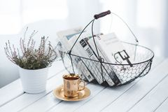 Golden cup and basket with books Royalty Free Stock Photography