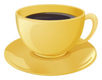 A golden cup with a dark coffee Royalty Free Stock Photos