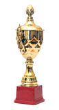 Golden cup. Isolated on white stock photography