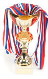 Golden cup, medals with tape Stock Photo