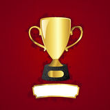 Golden cup and metal plaque Stock Photography