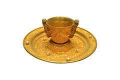 Golden cup and plate Stock Photography