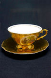 Golden cup of tea Royalty Free Stock Image