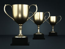Golden cup trophies. Isolated on a dark background Royalty Free Stock Photos