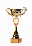 Golden cup of the winner on white background Stock Photo