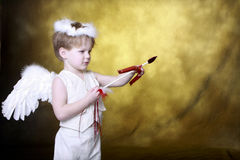 Golden Cupid. Cupid with Bow and Arrow and Golden Background stock photos