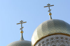 Golden cupola and christian cross on church Stock Photo