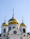 Golden Cupolas Church. Outdoor view of an orthodox church with three shiny golden cupolas Royalty Free Stock Photo