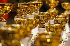 Golden cups Stock Images