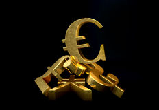 Golden currency euro symbol rising over a pile of Pound,US Dollar,Yen. Stock Photo