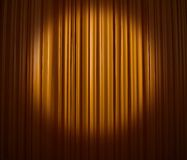 Golden curtain with spotlight Stock Images