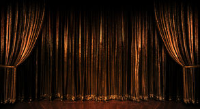 Golden Curtains. Stage golden curtains over wooden floor Stock Image