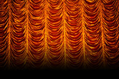 Golden curtains. In a theatre royalty free stock image
