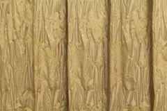Golden curtains with a pattern in the form of flowers Royalty Free Stock Images