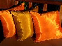 Golden cushions 2. Richly colored cushions during sunset stock images