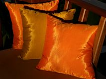Golden cushions 3. Richly colored cushions during sunset royalty free stock images