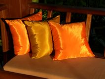 Golden cushions. Richly colored cushions during sunset stock image