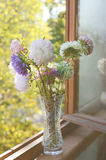 Golden-daisy bouquet in crystal vase Stock Images