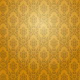 Golden damask wallpaper. Stock Photo