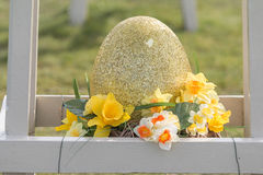 Golden Decorated Diamond Dust Egg. Decorated with Yellow Flowers and White Orange Prim Roses royalty free stock images