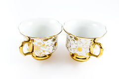 Golden decorated porcelain coffee cups Stock Images
