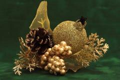 Golden decoration. Golden Christmas decorations on green velvet Stock Photos