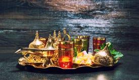 Golden decoration oriental lantern Tea glasses mint leaves vinta Royalty Free Stock Images