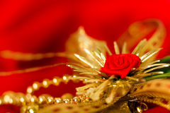 Golden decoration on red fabric. macro Royalty Free Stock Photos