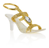 Golden decoration shoe isolated on the white background Royalty Free Stock Photos