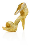 Golden decoration shoe isolated on the white background Stock Images