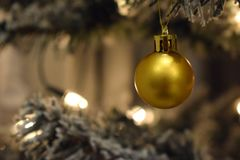 Golden decoration in a white Christmas tree Royalty Free Stock Photo