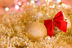 Golden decorations for Christmas card. Golden Christmas decorations, balls and red bow for card Stock Image
