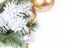 Golden decorations   and fir branch Royalty Free Stock Photography
