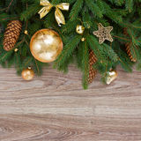 Golden decorations green fir tree border Stock Photo