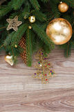 Golden decorations with green fir tree Stock Photos