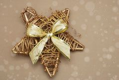 Golden Decorative Christmas Star with Glitter and Big Bow. Copy Space. stock image