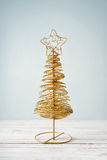 Golden decorative christmas tree Stock Image