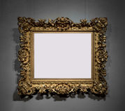 Golden decorative frame for painting on wall Stock Photography