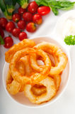 Golden deep fried onion rings Royalty Free Stock Images