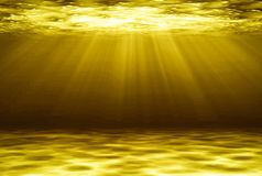 Golden deep water abstract natural background. Royalty Free Stock Photos