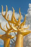 Golden deer statue for Christmas decoration. Stock Photo