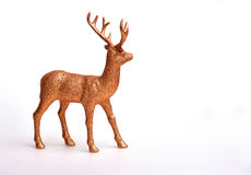 Golden deer. Toy on white background Stock Photos