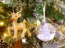 Golden deer tree ornament in light Stock Photos