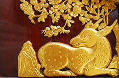 Golden deer on wall Royalty Free Stock Image