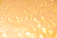 Golden defocused blurred background texture with bokeh Royalty Free Stock Image