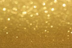 Golden defocused flickering lights for text and background stock image